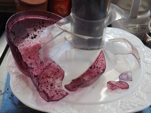 Grape juice covered plastic shards from my exploding juicer.