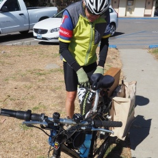 Cyclist brings in roadside trash