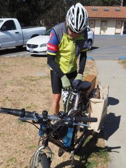 Cyclist brings in roadside trash